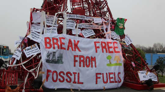 A protest against fossil fuels during the recent UN climate change conference in Paris. Image: Takver via Flickr